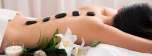Receiving Hot Stones Massage Treatment